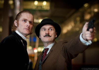 Sherlock Holmes and Dr Watson Murder Mystery Actors With Gun