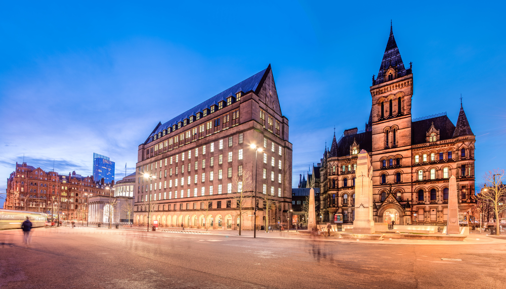 Manchester new and old town halls at sunset