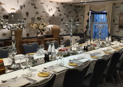 Voyager private dining room at the Mandeville Hotel set for murder mystery dinner